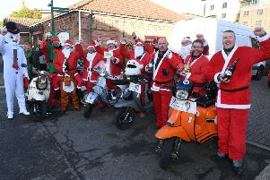 Sleaford All Knighters setting off from Barge and Bottle, Sleaford, to deliver gifts to Roxholme Hall care home. EMN-191216-090611001