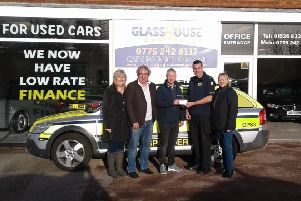Lou and Dan Couling, Neil and Sally Donner and Paul from Glasshouse Car Sales handed a cheque for ?3,580.74 to Tony Dimmock of LIVES. EMN-191216-152516001