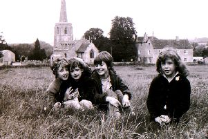 A scene from the fields around Ancaster church in 1970 - were you one of these village youngsters? EMN-191112-165214001