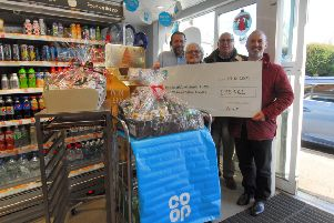 Fr Knox (right) with store manager Matt Sumner, Lesley Fixter (Co-op community pioneer) and Trevor Wells (church fundraiser). EMN-191227-175317001