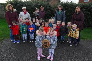Staff of Ruskington's Rascals Preschool, from left - Vikki King, Linda Ashby (owner), Catherine Turner, Laurie Mitchell and Anna Burton with children outside showing off their Green Tree School gold award plaque. EMN-200116-180324001