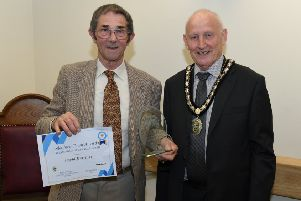 Sleafordian of the Year 2019, David Marriage, receiving hi saward from Mayor of Sleaford Coun Grenville Jackson. EMN-200202-131025001