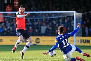 Hatters midfielder Ryan Tunnicliffe in action against Cardiff this afternoon