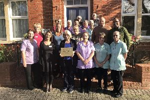 Staff from Wisteria Lodge are celebrating