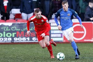 Cliftonville's Ross Lavery and Rhys Marshall of Glenavon. Mandatory Credit �INPHO/Philip Magowan