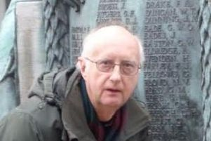 Painstaking research: Dr Graham Mayhew at Lewes War Memorial