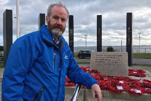 Cllr Billy Henry, who served in the RUC and armed forces during The Troubles, at the war memorial in Carrickfergus