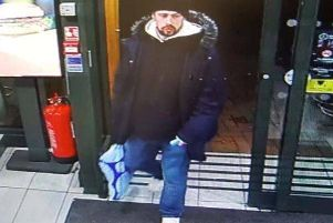 Police have released CCTV in connection with a handbag theft from McDonald's in Aylesbury