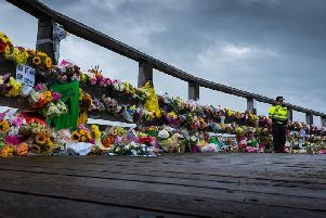 Floral tributes laid at Old Toll Bridge in Shoreham following the tragedy