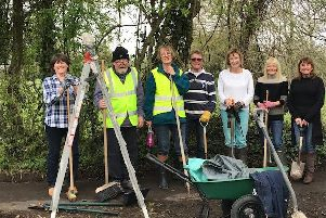 The determined team used  various equipment for the tidy up
