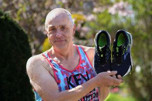 Running shoes at the ready ... Kevin Miller will pound the streets of London
