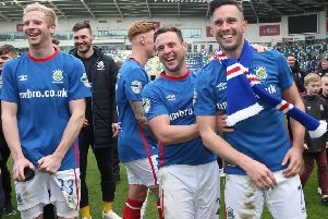 Linfield's Ryan McGivern, Andrew Waterworth and Jamie Mulgrew celebrate