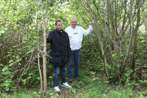 DM1951894a.jpg. Southwick Allotment holder Kevin Hartley, right, wants to take over disused land. Pictured with Mark Woodley. Photo by Derek Martin Photography. SUS-191105-194622008