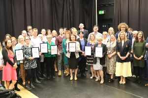 The award-winning schools with their certificates