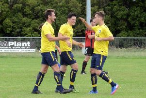Sidlesham celebrate a goal at home to Billingshurst / Picture by Kate Shemilt