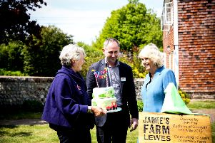 Cake ... founders Tish and Jamie Feilden with the Duchess of Cornwall. Image: Sophie Mitchell Photography