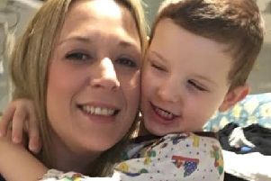 Proud mum: Lizzie Pullen with her son George, four