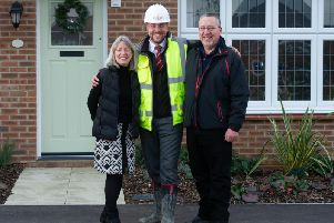 Three members of the Scheu family (Peter, Ann and Bob) outside the parents home