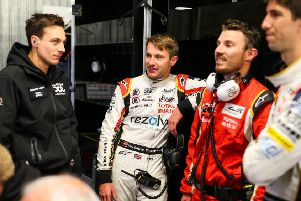 Jordan King, centre, behind the scenes with his Jackie Chan DC Racing x Jota team-mates. Picture: Antonin Vincent / DPPI