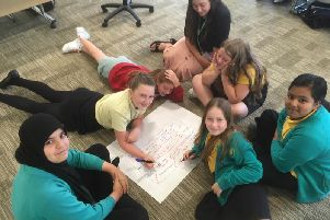 Students discuss gender role stereotyping as part of developing healthy relationships