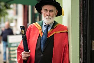 Devoting 30 years of his life to conflict resolution, Eamonn Baker received the honorary degree of Doctor of Laws (LLD) for services to conflict resolution and to the community in the North West of Ireland. (Photo: Nigel McDowell/Ulster University)
