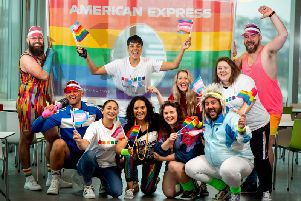 American Express staff celebrate love dressed as LGBTQ+ icons from the 80s.