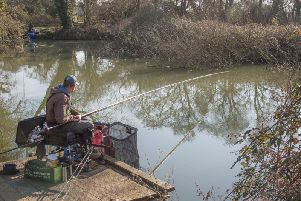 Angling club chairman Keith Hughes shows how it's done