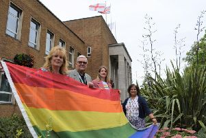 Clara Wicks (centre right), trustee of Warwickshire Pride, joins Cllr Derek Poole, Chair of Rugby Borough Council's equality and diversity steering group, Cllr Belinda Garcia (left), Deputy Chair, and Minakshee Patel, Equality and Diversity officer, to raise the rainbow flag.