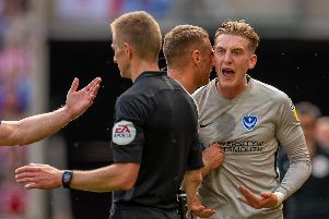 Ronan Curtis argues with referee Michael Salisbury during the game against Sunderland Picture: Malcolm MacKenzie