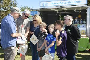Littlehampton  Town Show ''The Jackson family get advise on waste prevention from Adam Swain from West Sussex Waste Prevention Team. 'Picture: Liz Pearce ''14/09/2019''LP191393 SUS-190915-221157008