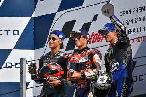 Marc Marquez on the podium with runner-up Fabio Quartararo and Maverick Vinales.