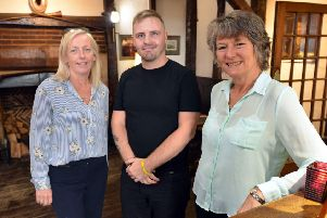 White Hart owner Sally Ayris with staff. Photo by Peter Cripps