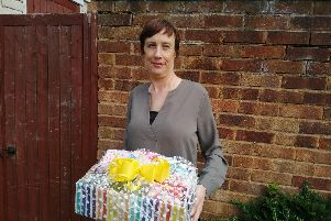 Stacey Woolerton with one of the care packages.