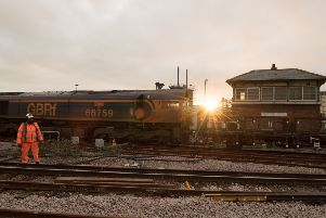 Signalling and trackwork continues as the sun rises over Newhaven Harbour and its former signal box. Picture: Graham Price