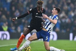 Brighton and Hove Albion skipper Lewis Dunk in action against Chelsea