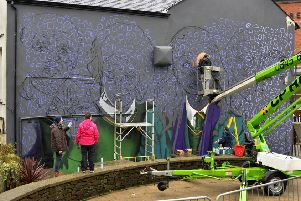 Work began yesterday on large mural of the Derry Girls on the side of 'Badger's Bar' on Orchard Street. Locally based UV Arts will immortalise the main characters Erin, Orla, Clare, Michelle and James in paint over the next couple of days. DER0419GS-021