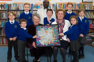 The dedication ceremony of a piece of tapestry art by Elizabeth Brown to Oakley School.'The dedication was conducted by vicar at St Mary Magdalene Church, Shabbington, Rev David Kaboleh.'He is pictured with Oakley School headteacher Caroline Witton (front right) and a representative from each school year.