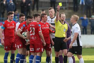 Conor Pepper is shown a yellow after Coleraine were awarded a third penalty