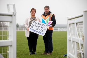 """Vickie White, RUAS, joins Clive Richardson, Managing Director at Clive Richardson Ltd to celebrate the company�""""s sponsorship of the CRL Arena."""