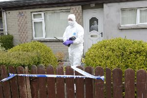 Crimes officer pictured at the house in Windmill Avenue, Armagh where three people escaped injury when two pipes bombs exploded at the property in the late hours of Tuesday night.'Photograph-Stephen Hamilton/Presseye