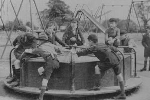 An early merry-go-round at Wicksteed Park. The team which keeps alive the history of the Kettering park has been praised with an award.