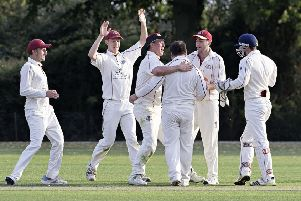 March players celebrate the wicket of Wisbech legend Gary Freear for 71. Ben Pyle (back view) was the successful bowler. Photo: Pat Ringham.