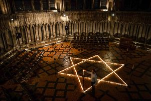 600 candles form a Star of David in Chapter House at York Minster to mark Holocaust Memorial Day last year, 2019. Credit: Alex Cousins SWNS.