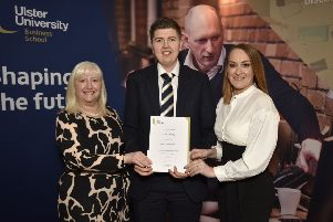 Sam Cherry is  presented with his awards by Charlotte Maguire (right), First Trust Bank and Dr Mary Boyd, associate head of Department of Management, Leadership and Marketing.