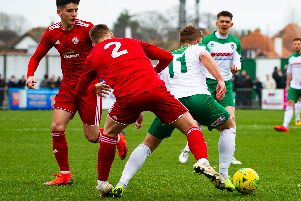 Mason Walsh looks for a way past two Worthing men / Picture by Tommy McMillan