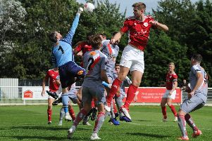 Altrincham keeper Steve Drench punches clear from Brackley Town's James Armson