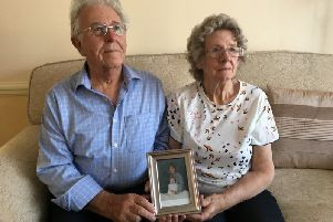 Peter and Elizabeth Skelton with a picture of their daughter Susan Nicholson
