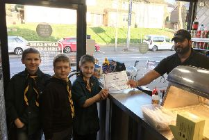 Corey MacDonald, Eryk Rupp and Dylan Barnes presented the certificate to the shop