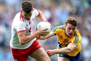 Tyrone's Richard Donnelly and Niall McInerney of Roscommon