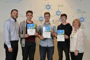 Pictured with Gary Parkinson, Director of Servcies at Novosco and Dr Nicola Ayre, Associate Head of the School of Computing at Ulster University are students Jamie Stinson, Ethan Cardwell and Conor Brolly.